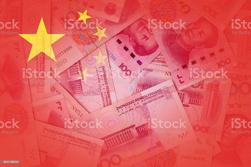 Transparent Chinese flag with chinese currency in background stock photo