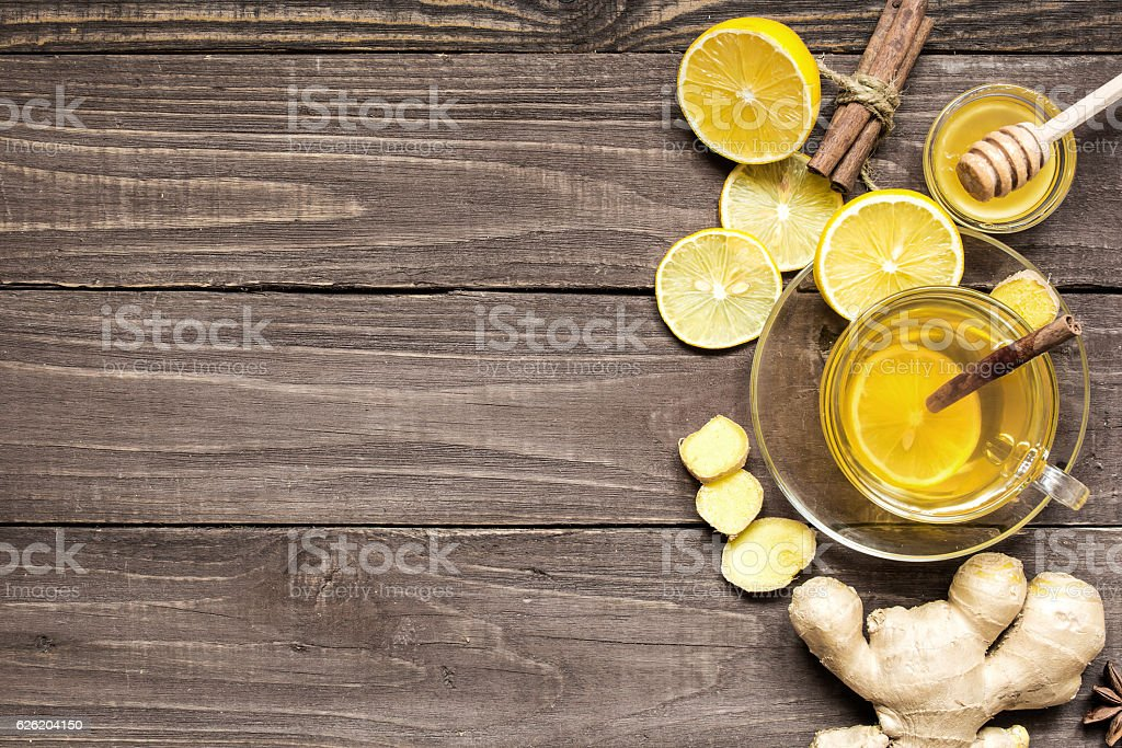 transparent cup of green natural tea with ginger, lemon, spices stock photo