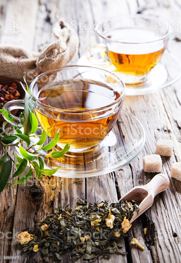 Transparent cup of green tea stock photo