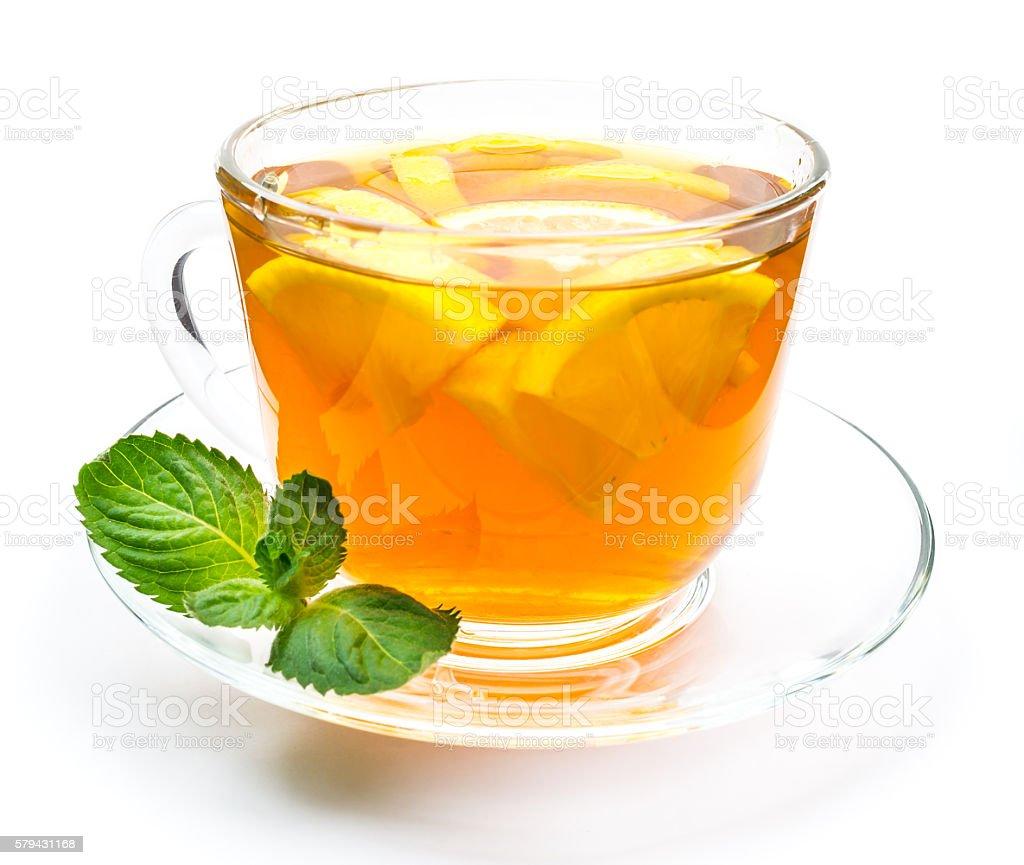 Transparent cup of lemon tea and mint stock photo