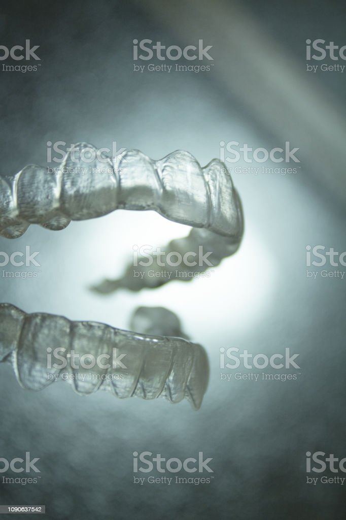 Transparent dental orthodontics to correct dental alignment. No people stock photo