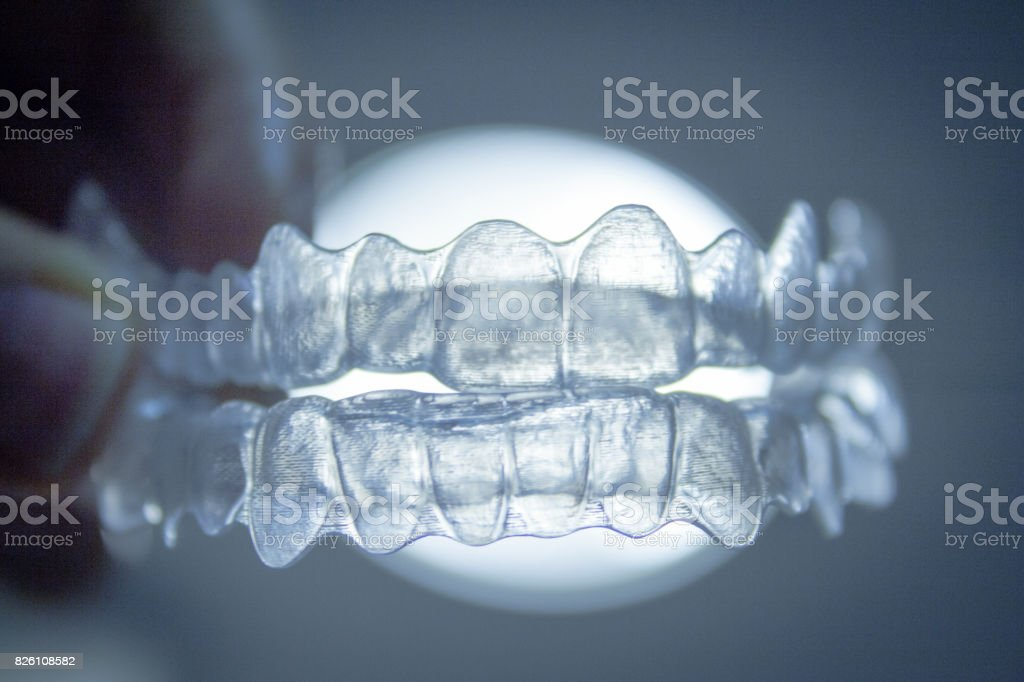 Transparent dental orthodontics with white light background stock photo