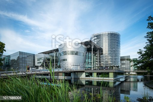 Dresden, Germany - August 07, 2018: The Transparent Factory of the German carmaker Volkswagen, designed by architect Gunter Henn in 2002 as a factory for cars and an exhibition space in Dresden. In 2016 it was reopened for a new electro mobility car.