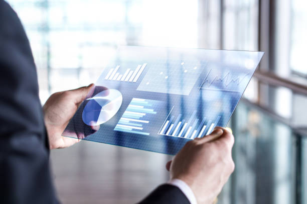 transparent futuristic tablet. business man using virtual touch screen. modern mobile technology in accounting, finance, data and analytics. - прозрачный стоковые фото и изображения