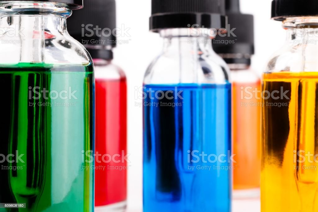 transparent glass bottles filled colored liquid with dropper stock photo
