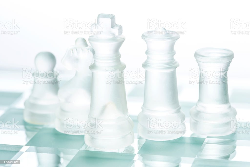 Transparent glass chess isolated on white royalty-free stock photo