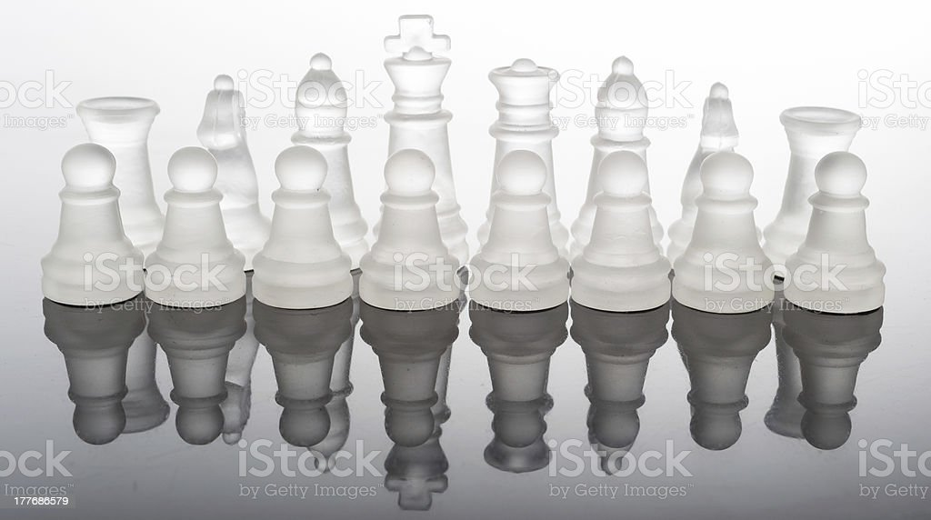 transparent glass chess pieces with reflection royalty-free stock photo