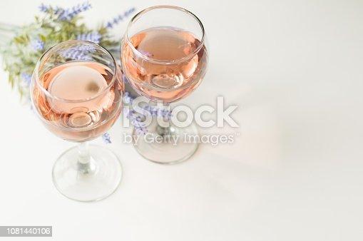 istock Transparent glass of wine. Pink wine 1081440106