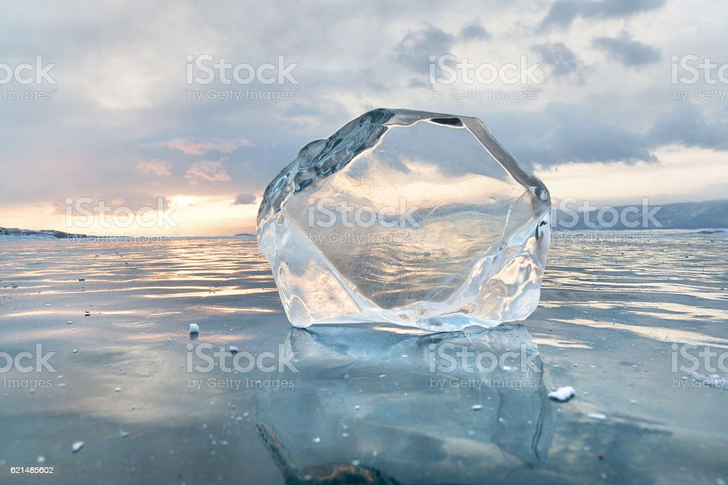 Transparent ice floe at frozen surface with reflection. Winter foto stock royalty-free