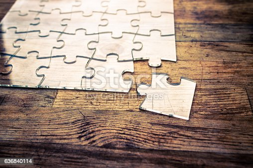 istock Transparent Jigsaw puzzle on wood background 636840114