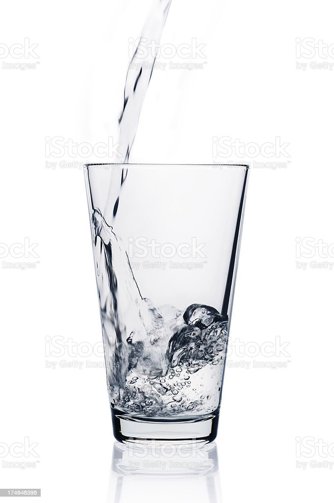 transparent liquid pouring into glass stock photo more pictures of
