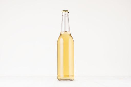 Transparent longneck beer bottle 500ml with lager, mock up.