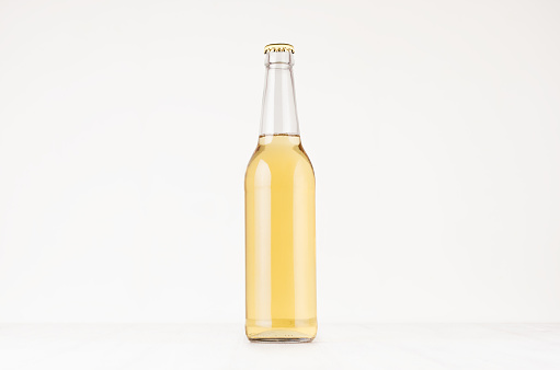 Transparent longneck beer bottle 500ml with lager, mock up.