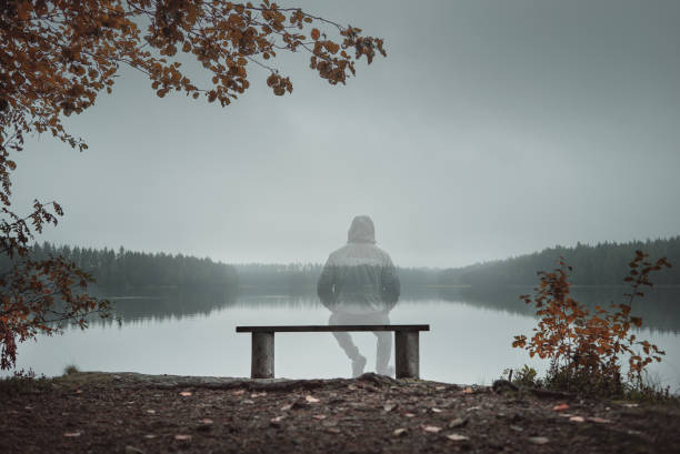 Transparent man is sitting on a bench and looking at the lake back picture id1039546272?b=1&k=6&m=1039546272&s=612x612&w=0&h=x2klk zk7ws4nscioscivf1n7fl8h7v5 zcvbeydxpg=