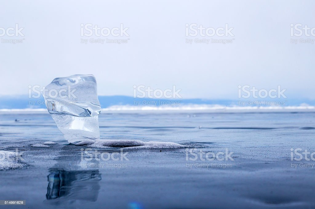 Transparent piece of ice on the surface of lake Baikal stock photo