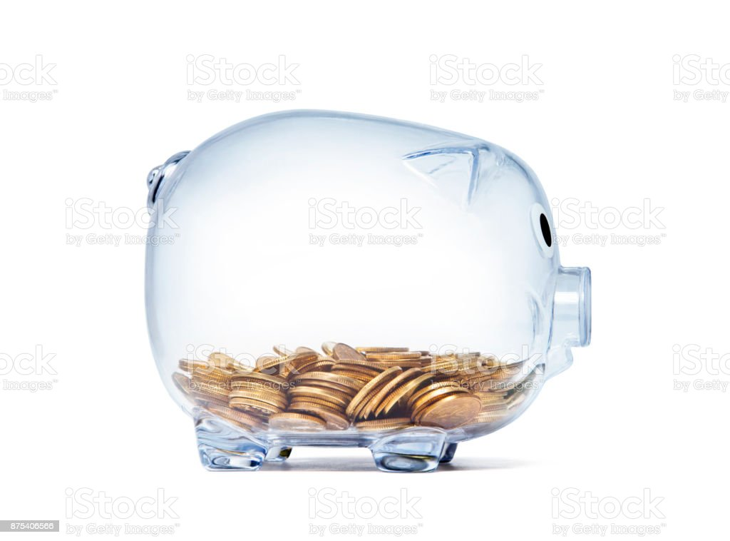 Transparent piggy bank with golden coins on white background with clipping path stock photo