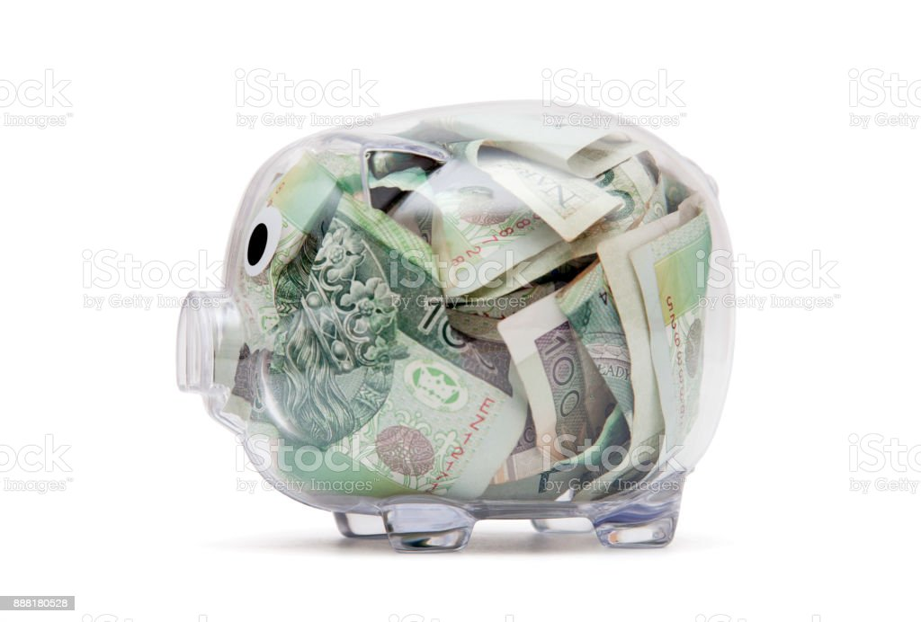 Transparent piggy bank with polish money stock photo