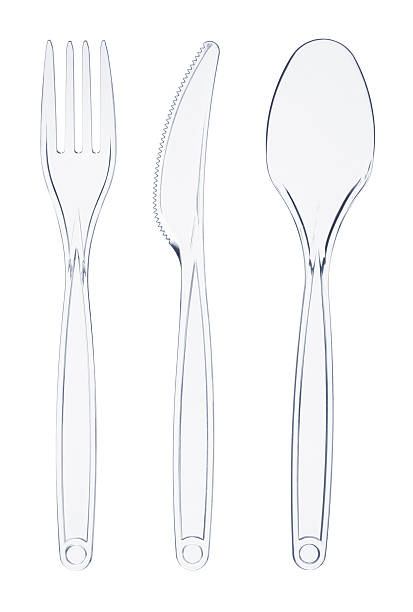 Transparent plastic cutlery, fork, knife and spoon on white background stock photo