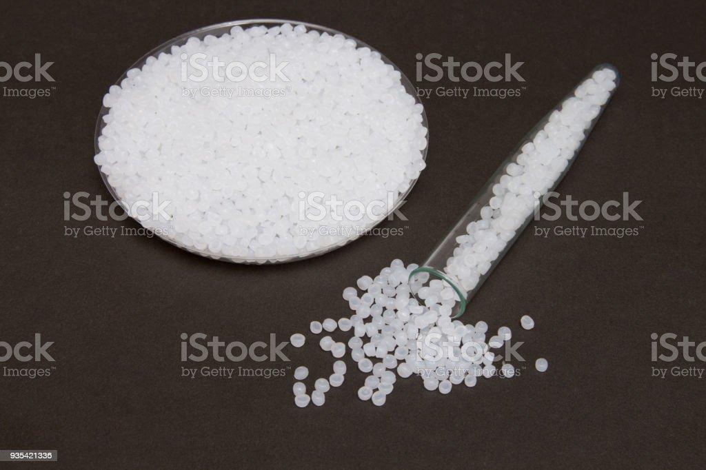 Transparent Polyethylene granules.Plastic granules. Plastic Raw material in pellets.High Density Polyethylene (PE-HD).PE-LD. FREE BPA. stock photo