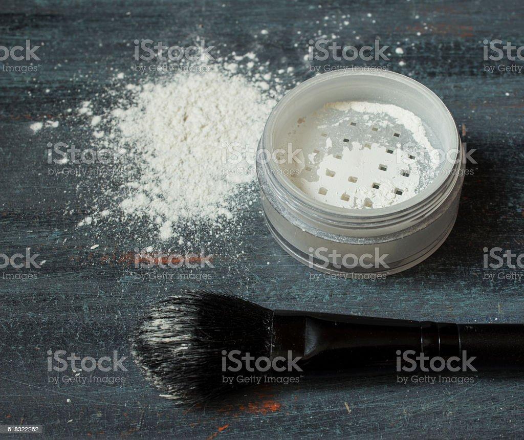 Transparent powder and black brush for makeup stock photo