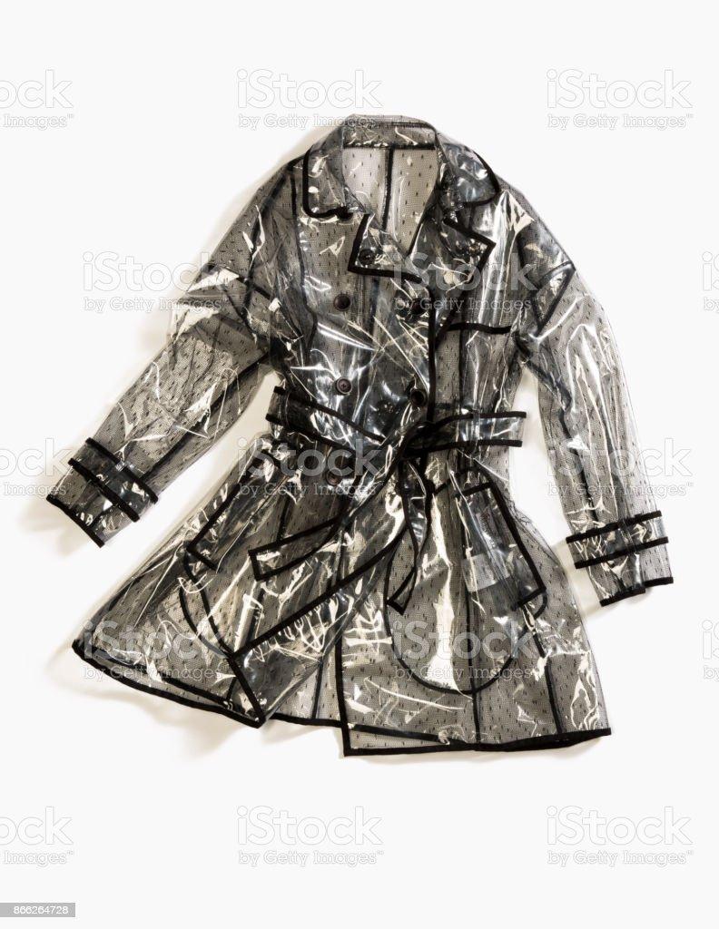 Transparent raincoat isolated on white background stock photo