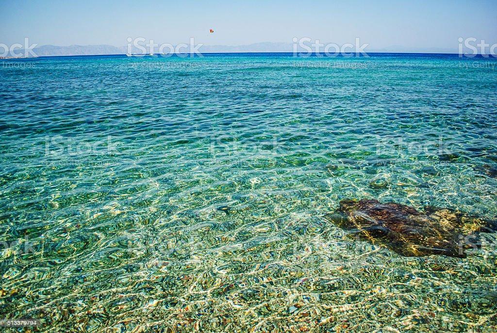 Transparent rocky sea stock photo