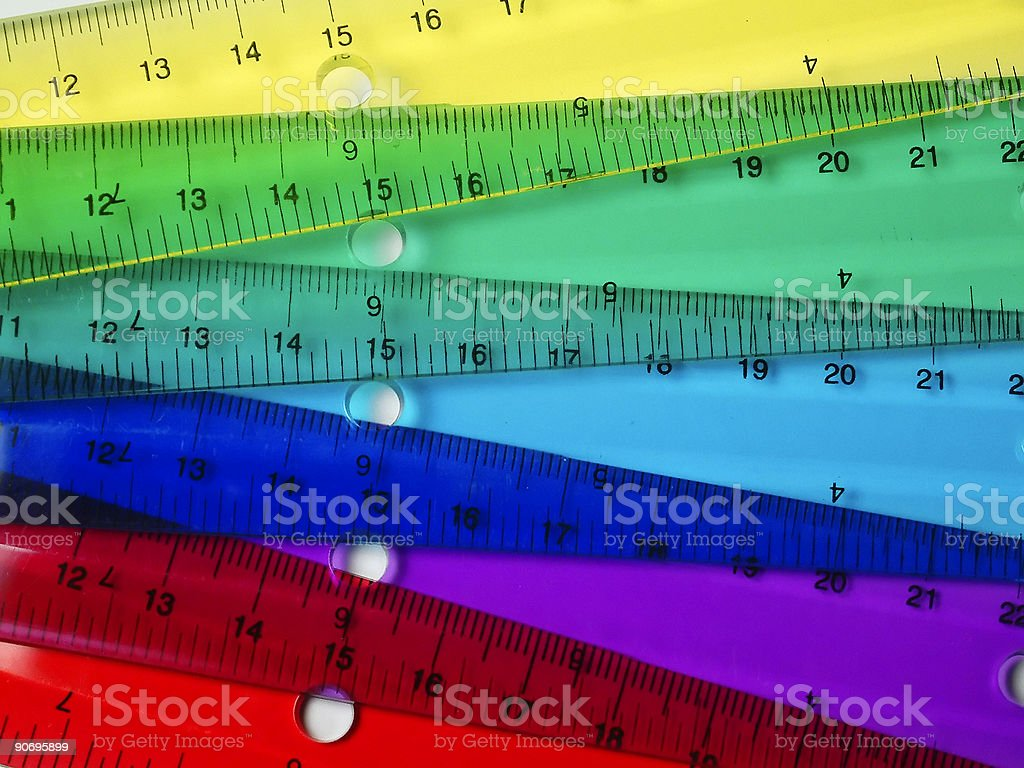 Transparent rules of many colors make a rainbow stock photo