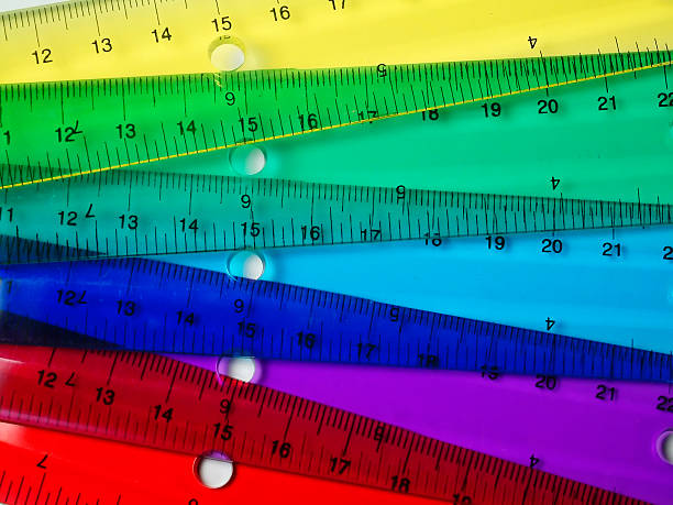 transparent rules of many colors make a rainbow - ruler stock photos and pictures