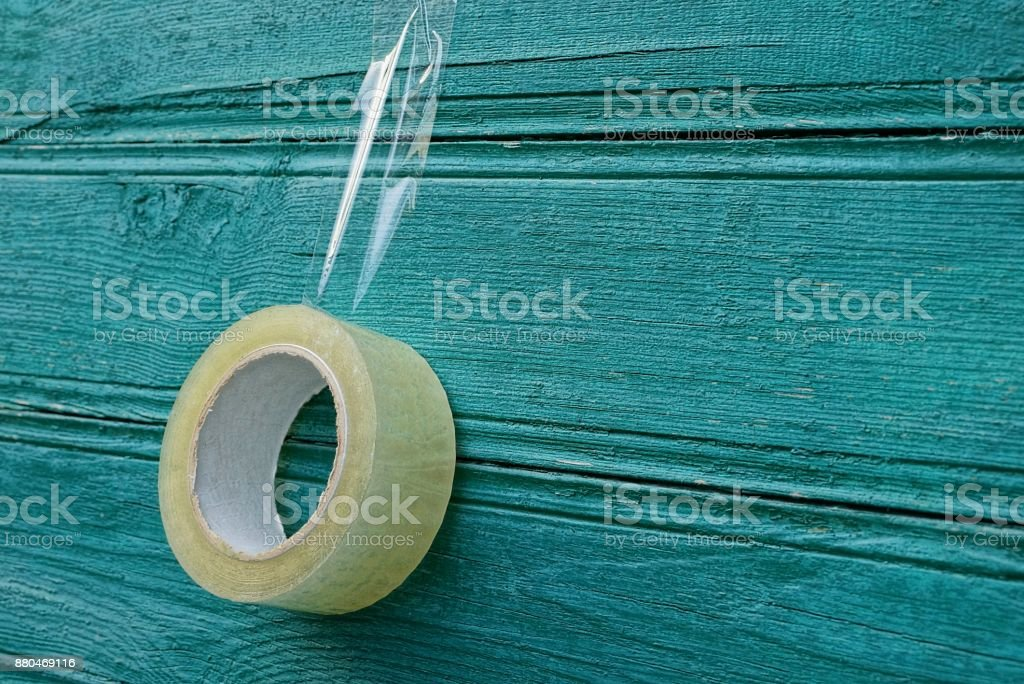 transparent scotch hanging on a green wooden wall stock photo