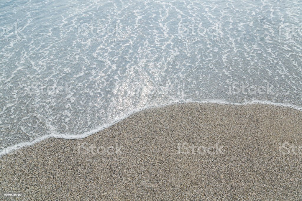 Transparent sea and beach. Pebbles background. royalty-free stock photo