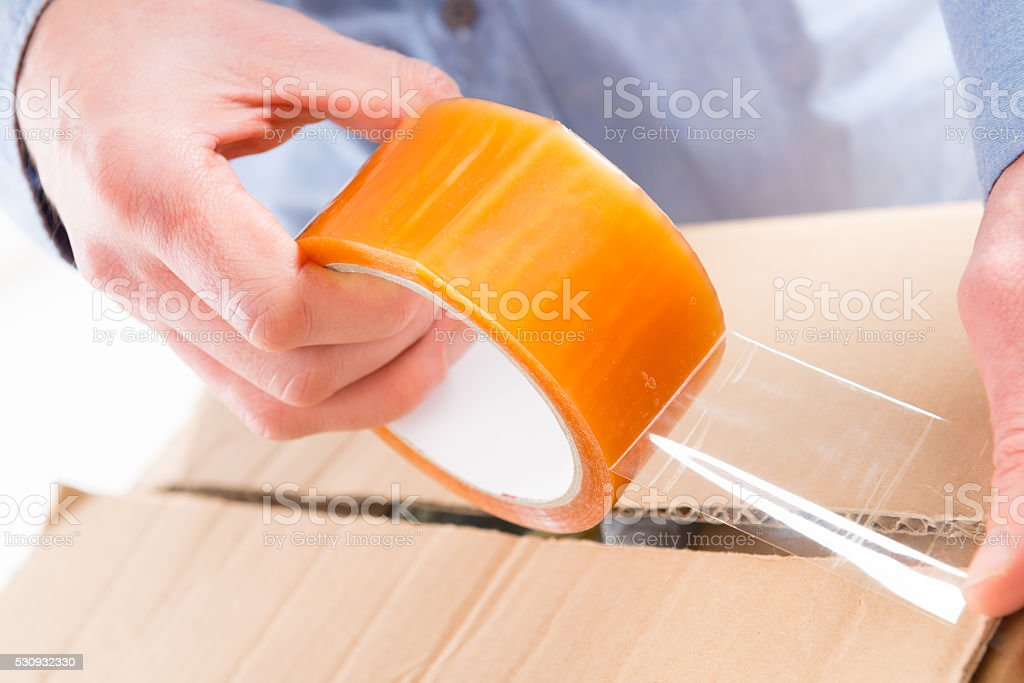 Transparent tape in hands stock photo