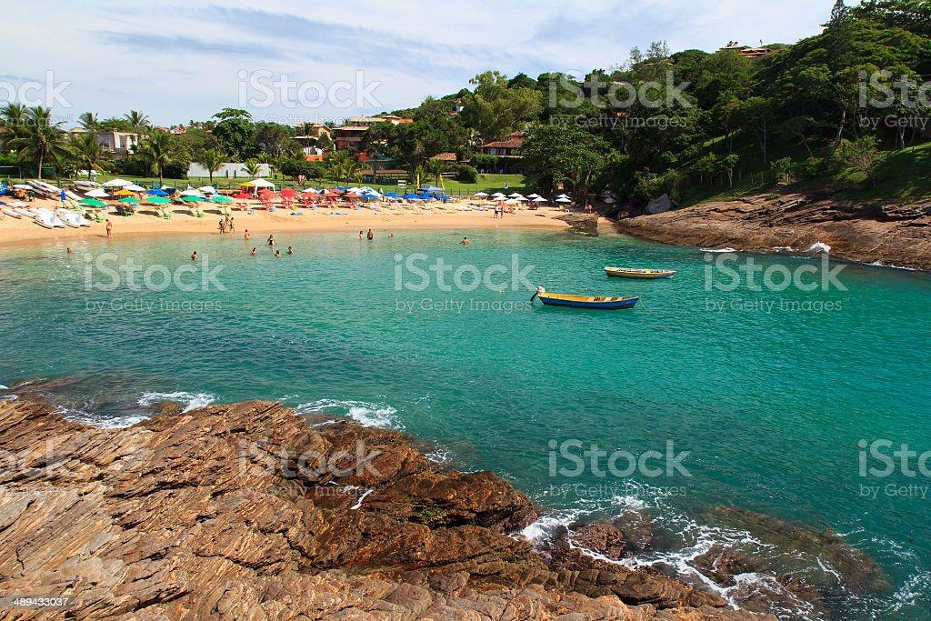 Transparent water of beach Ferradurinha in Búzios, Brazil stock photo