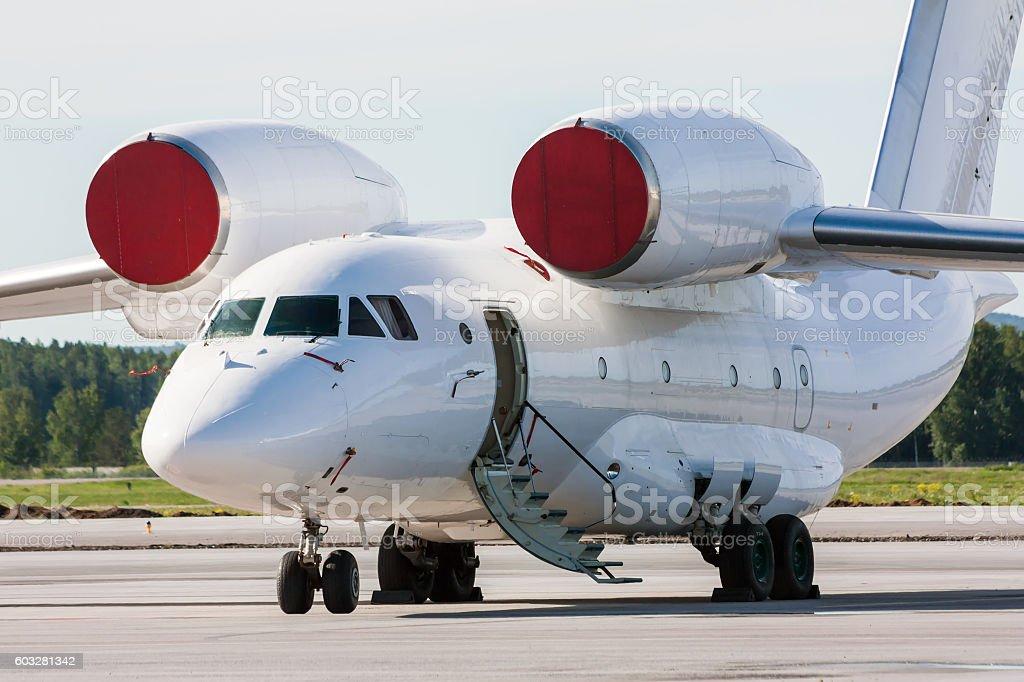 Transport aircraft with open airstair on the airport apron royaltyfri bildbanksbilder