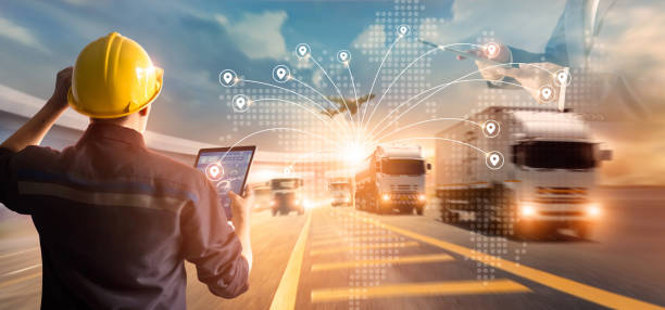 Transport and logistic concept, Manager and engineer checking and controlling logistic network distribution and data on tablet for logistic Import export on motorway background stock photo