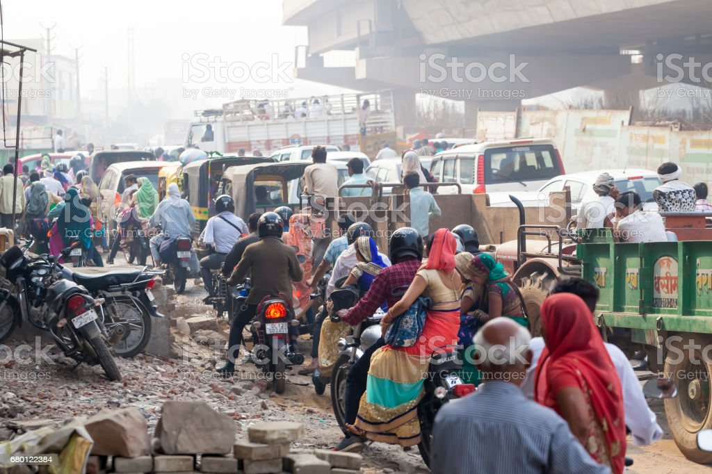 Transport and people on the roads of India. India, Vrindavan, November 2016 stock photo