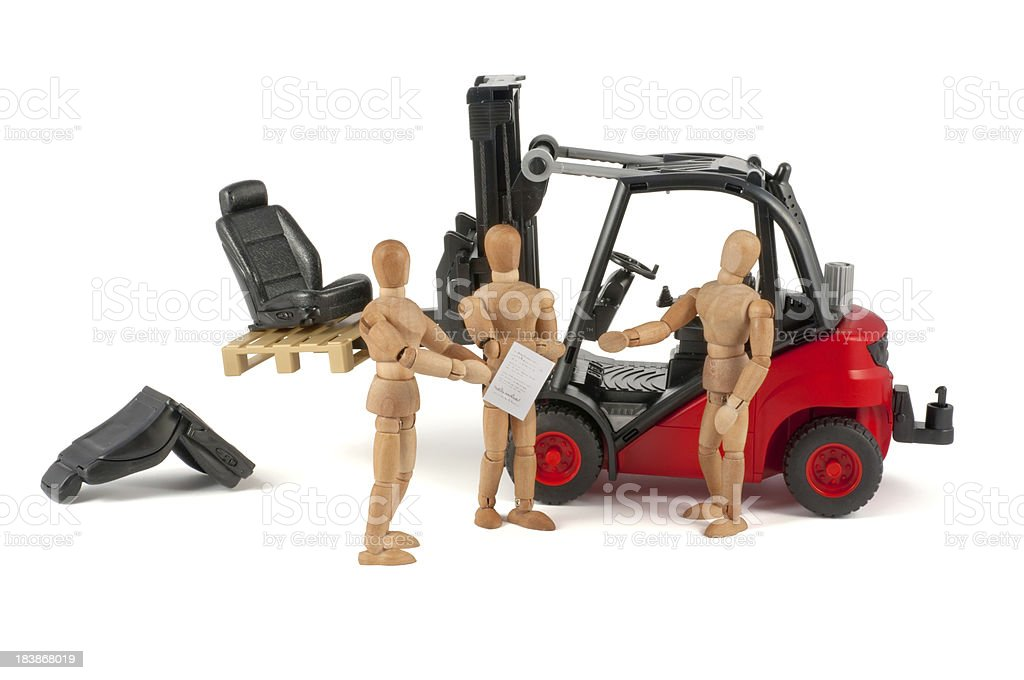 transport damage with forklift - wooden mannequin at work royalty-free stock photo