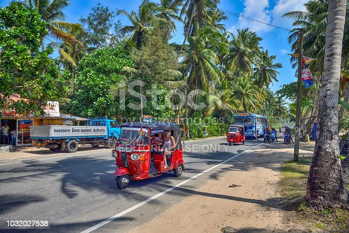 Talpe, Sri Lanka - JANUARY 10, 2017: Bus and tuk tuk is the most popular vehicles on country roads
