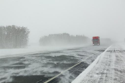 Transport moves along an asphalt road