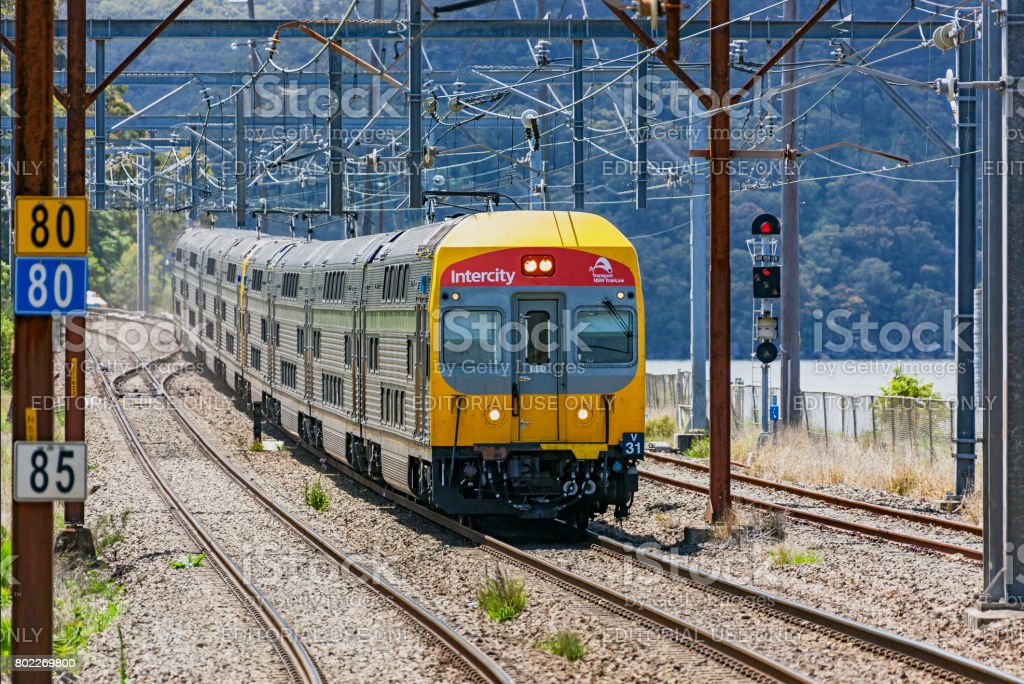 Transport NSW TrainLink Intercity service travelling in rural setting stock photo