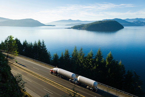Transport truck driving along Highway 99, BC, Canada