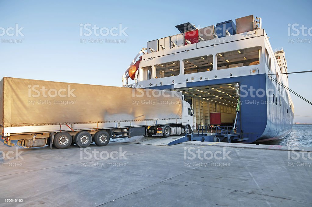 Transport truck entering a transport shipping barge royalty-free stock photo