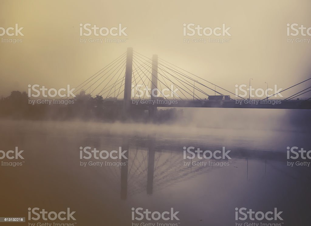 transport truck on a highway with fog and sunrise, vintage stock photo