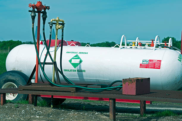 Transportable anhydrous ammonia container on farm in Iowa Transportable anhydrous ammonia container with built-in water treatment station in case of exposure on farm in Iowa anhydrous stock pictures, royalty-free photos & images