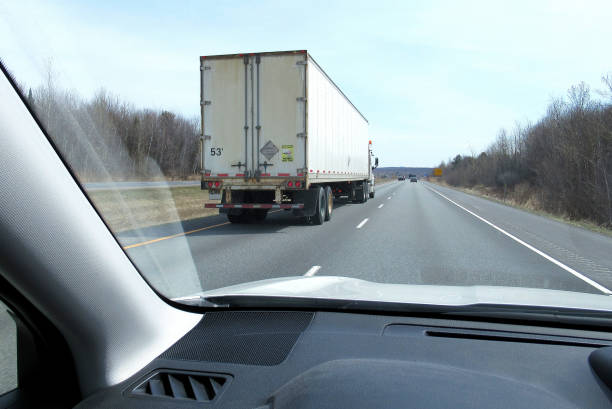 Transportation, 53 Foot, Transport Truck. Transportation...This shot, from a moving vehicle, shows a large freight Transport truck passing our car. This view is on a rural highway in eastern Canada. alongside stock pictures, royalty-free photos & images