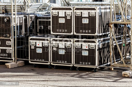 istock Transportation and storage of concert equipment. Containers and boxes with metal trim on wheels. Carrying crates 1158027611