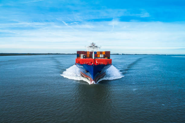 Transportation at sea Marine life, working on a ship at sea. Transporting containers from port to port. container ship stock pictures, royalty-free photos & images