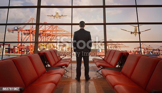 638310484 istock photo Transportation concept with businessman standing at airport 883781962
