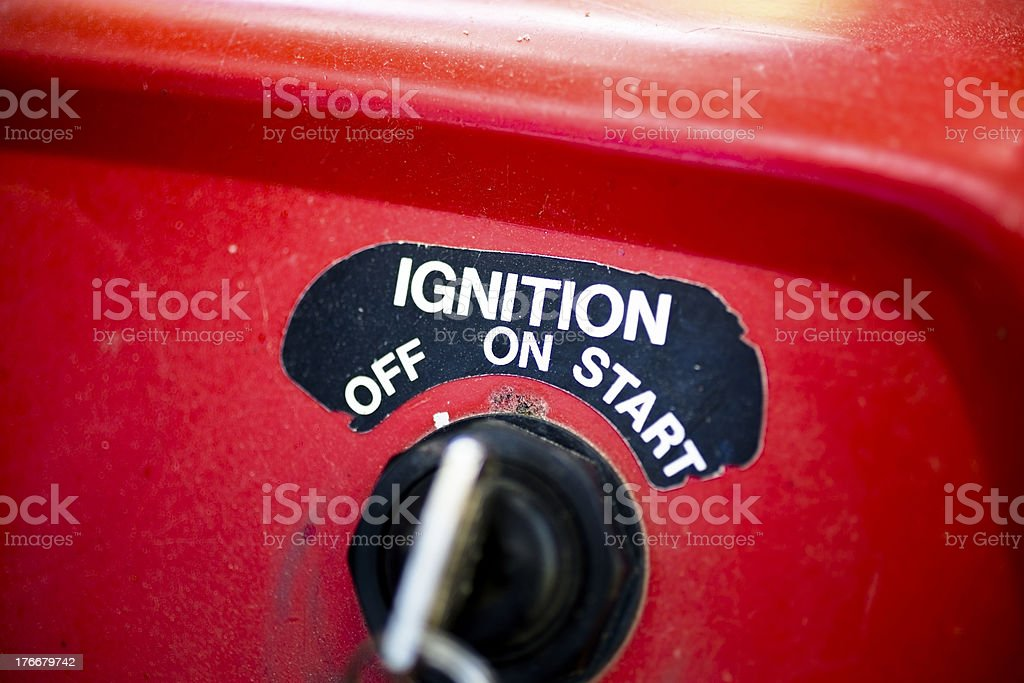 Transportation:  Ignition and key to red ATV. royalty-free stock photo