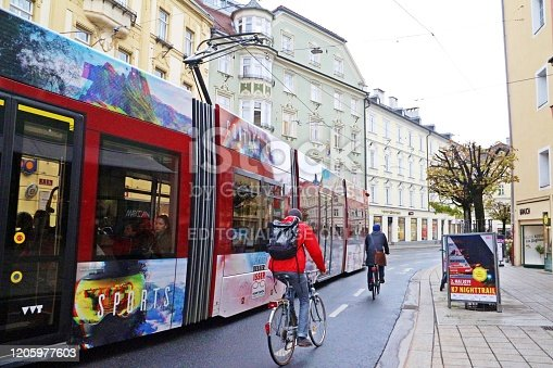 Innsbruck, Austria - April 08, 2019 Public transport in Innsbruck or the Innsbrucker Verkehrsbetriebe (IVB). There are buses and trams. People also ride bicycle