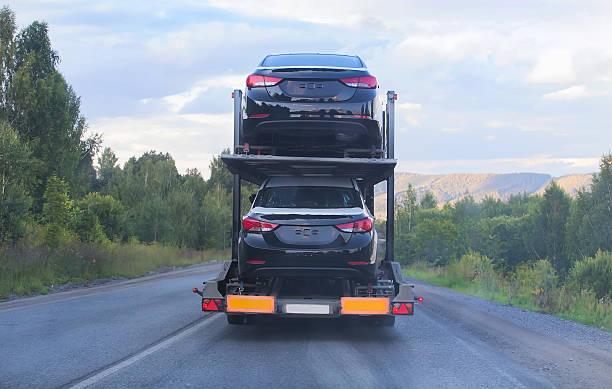 transportation of car on semi-trailer stock photo